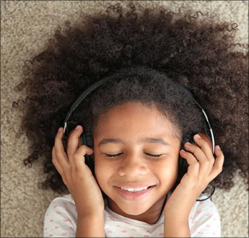Child listens to audio story